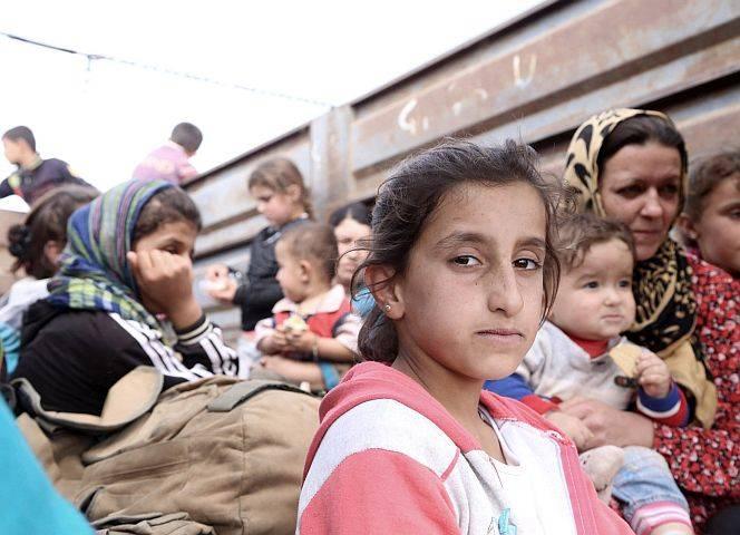 Syrische Kurden auf der Flucht vor den Dschihadisten des IS. - © Elif Ozturk/Anadolu Agency/Getty Images